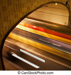 Tunnel Light Trails - Night traffic light trails on a street...