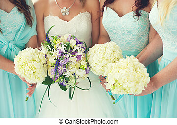 Bride and Bridesmaids bouquets - Close up of bride and...