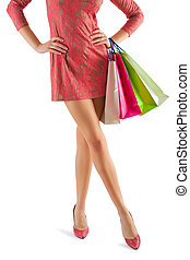 close up view on beautyful female legs and paper bags in her...