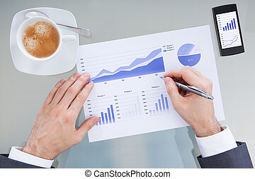 Businessperson Hand With Pen Over Graph Diagram - Close-up...