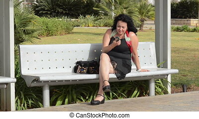 Woman laughs calling by phone