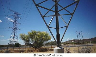 Electrical Pylons Pan Up - Panning up from a horizontal to a...