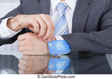 Businessperson Removing Credit Card From Sleeve - Close-up...