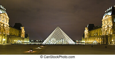 Louvre Museum in Paris at night, France