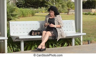 Frustrated lady counts money in her purse