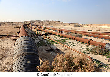 Oil and gas pipeline in the desert of Bahrain, Middle East