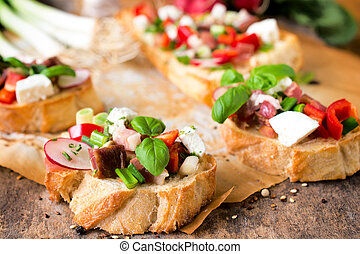 Spring salad bruschetta - Selective focus on the front...