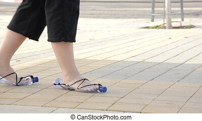 Feet walk in plastic bottle