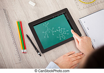 Hand Over Molecule Structure On Digital Tablet - Close-up Of...