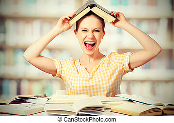 wild girl student with glasses shouts with books - funny mad...