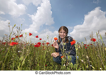 Girl with poppies squatting wide - Girl on the meadow posing...