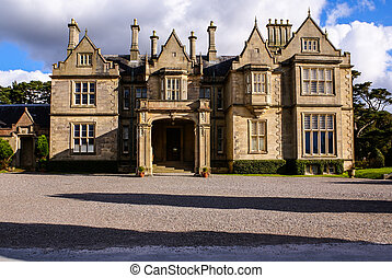 Muckross House and gardens in National Park Killarney,...