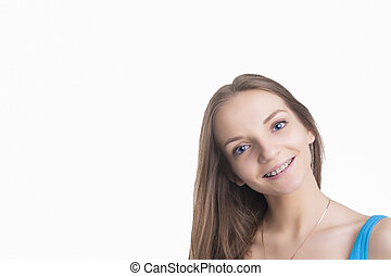 Pretty Blond Girl With Brackets on Her Teeth. Isolated Over...