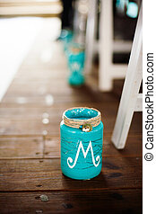 Jar - Teal jar on the wooden floor at a wedding