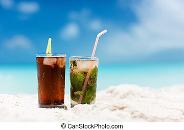 Tropical cocktails - Mojito and Cuba Libre on a tropical...
