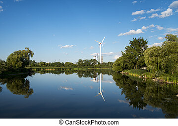 Windmill providing Clean Energy Surrounded by Blue Skies,...