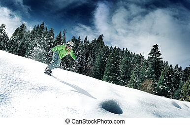snowboard - view of a young girl snowboarding in winter...