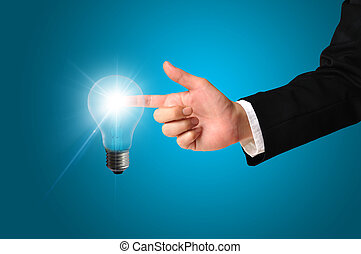 Business man touching light of idea