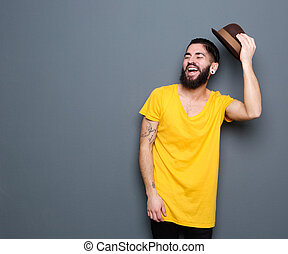 Happy young man with beard laughing - Portrait of a happy...