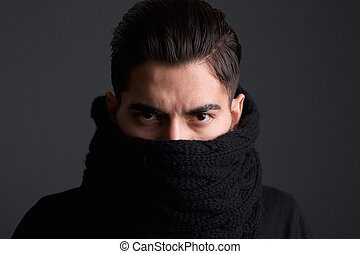 Intimidating young man with scarf covering face - Close up...