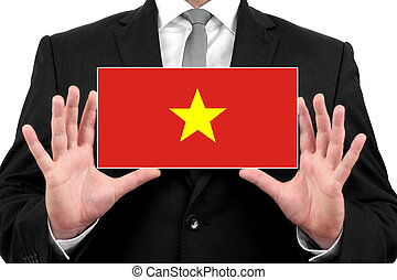 Businessman holding a business card with Vietnam Flag