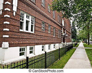 Old Brick Apartment - Brick apartment and sidewalk...