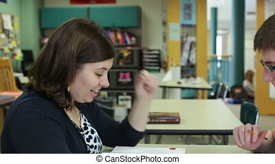 Teacher tutoring student - High school teacher tutoring a...