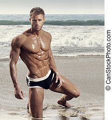 Sexy muscular guy - Fashion portrait of muscular fitness...