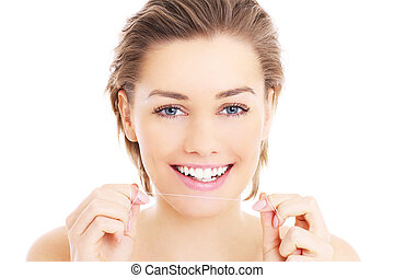 Woman with teeth floss - A picture of beautiful woman using...