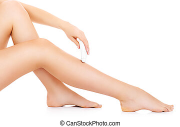Leg depilation - A picture of a young woman depilating her...