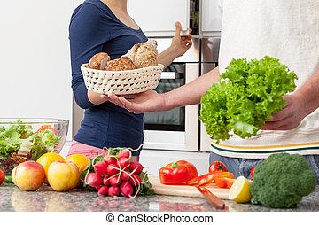 Vegetarian lunch - People in love preparing vegetarian lunch