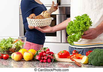 Vegetarian food - Vegetarian couple preparing healthy lunch...