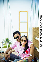 Lovely couple sit on the bridge3