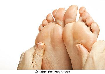 foot massage female legs - woman foot receiving gentle...