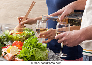 Wine at home - People drinking a glass of wine to dinner