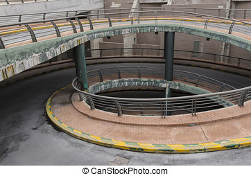 Spiral entrance parking - Spiral shaped entrance of a dirty...
