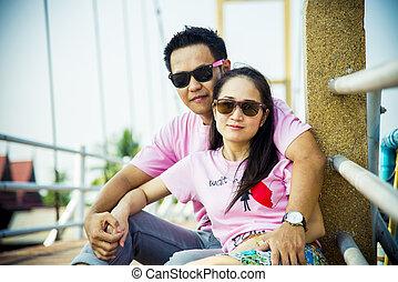 Lovely couple sit on the bridge2