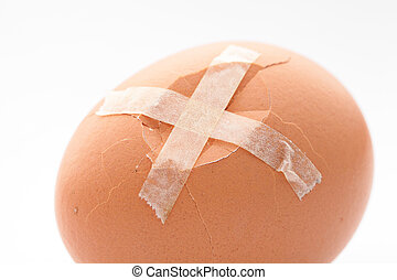 Brown egg with plaster