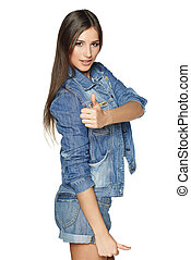 Happy denim girl showing thumb up sign - Happy young denim...