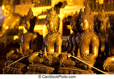 The bronze statues of Buddha in Wat Jedi Luang at Chiang...