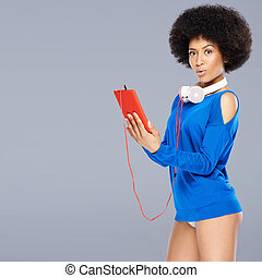 Stunning African American woman with a curly afro hairstyle...