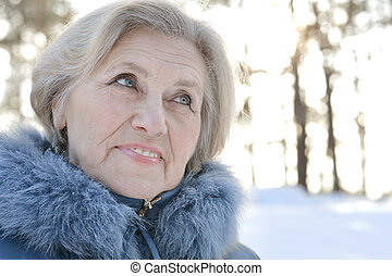Beautiful older woman on a walk in winter