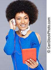 Beautiful Afro-American woman listening to music - Beautiful...