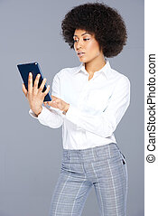 Attractive Afro-American woman with a tablet