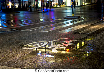 wet bicycle lane - painted symbol in bicycle lane on wet...