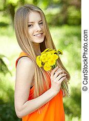 Spring girl lying on the field of dandelions - Spring girl...
