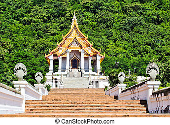 Beautiful thai church in front of the mountain