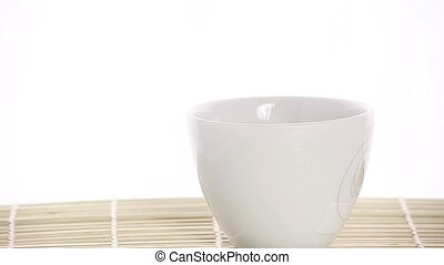 spoon with ground coffee on bamboo base and white background