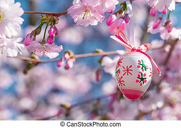 Easter egg on a flowering tree branch