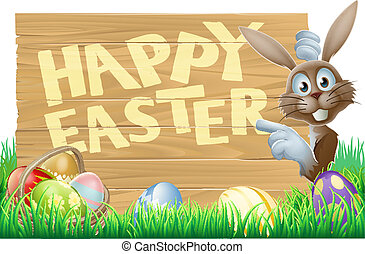 Easter eggs and bunny sign - Easter bunny peeking round a...